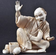 A LOVELY 19TH CENTURY JAPANESE MEIJI PERIOD IVORY OKIMONO depicting a startled artizan with a rat upon his leg. Signed.  3.5ins wide.