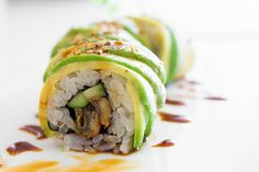 Unagi and cucumber sushi with an avocado wrapper. Learn how to make Caterpillar Rolls with step by step photos.