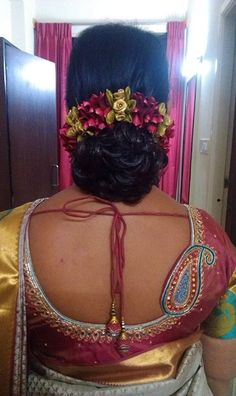 What a beautiful large braided low bun with gajra! Care however should be taken before adopting such hairstyles, as due to it's high static charge, it will cause phlegm to move up in the throat, causing the voice to quaver & a frequent urge to clear the throat. A heavy chabi chhalla with a long & wide hook if inserted at the edge of the pleats of the saree, will reduce this problem as it's hook will activate the acupressure points that act to keep the throat clear.