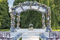 An altar covered in blue hydrangeas.