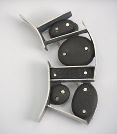 A wonderfully different Brooch in sterling silver, beach pebbles, and black jade ~ by Laurie Hall on http://www.facerejewelryart.com