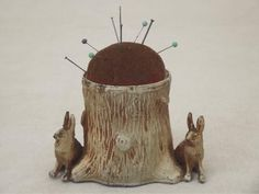 antique cast metal 'bronze' figural pincushion w/ tree stump &; rabbits
