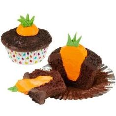 """Make chocolate cupcakes - freeze. Core out a cone shape hole. Instead of orange frosting, dip a strawberry into orange candy melts. """"somewhat easy"""" ratings.  This pin has other great Easter food ideas! :)"""
