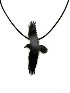 This awesome crow necklace, an Etsy Favourite, is hand cut and tooled from copper sheet and depicts a crow in flight.  My Process: I use a pierce and cut technique, making a series of inside and outside cuts with a tiny handheld jewelry saw to create the design. A patina is then added to the copper rendering it black to showcase the natural color of the crow. There is great attention paid to detailing the feathers in this piece as shown in the closeup image. A gloss finish has been applied…