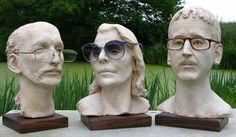 Busts with crowns and glasses on.