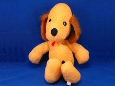 Looks a little like my dog toy from childhood, but I'm still searching... c1975 Animal Fair XL Gold Brown HENRIETTA Dog