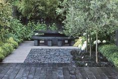Decorar un jardín en tonos grises y negros