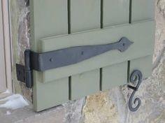 pretty green shutter with black hardware
