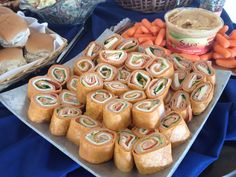 Pre wedding reception lunch item, smoked turkey wraps with cheese, roasted red peppers and spinach.  www.teatimeinc.com