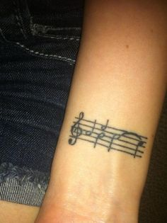 When You Wish Upon A Star | 24 Stunningly Subtle Disney Tattoos- i love the idea of the music for a song as a tattoo