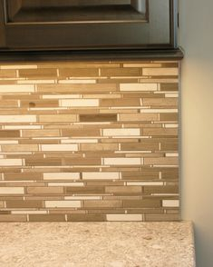 A traditional installation of a Schluter strip to cap off the end of a  #tiled. Backsplash ...