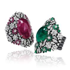 Tapered-band rings in white gold with brilliant-cut diamonds, rubies, emeralds and elastic shanks by Crivelli, Italy.