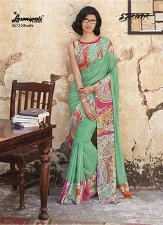 Majestic Mint Green Coloured Georgette Saree which makes you be the Cynosure of all the eyes with its eye pleasing colour combination and Heavy Digital Graphical Printed Lace. It comes Multicoloured Stencil Printed Pashmina blouse.