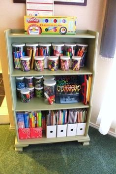 Nice way to organize kids craft supplies! Love the jars, will probably use mason jars instead. Use magazine boxes to organized crayon books, etc