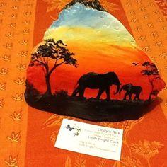 "Elephant African sunset ""Im here mum "" I love how loving elephants are to their babies #elephant #africansunset #rockart #art #paintedrock"