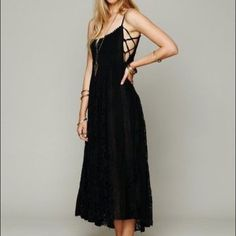 Free People FP One Victorian Lace Up Dress Black Free People FP ONE Victorian Lace Maxi Dress in Black. Rare Free People ONE Romantic Lace Maxi Dress in size Small.  Completely sold out, very difficult to find, especially in this size. Excellent condition. Worn a few times. Absolutely beautiful dress, perfect for summer with crisscross detailing on each side of upper bodice which are adjustable and adjustable straps. So flattering and looks perfect dressed up or down. Needs a slip underneath…