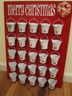 Easy DIY advent calendar using Dollar Tree pails and a large board. This is perfect for larger gift ideas instead of a small pocket.