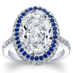 """""""She smiled and said with an ecstatic air: """"It shines like a little diamond"""", """"What does?"""" """"This moment."""" #WeddingRingWednesday !! 5 #carat #OvalCut #diamond #engagementring with white #pavé diamonds and blue #sapphires in #platinum   #unique #oneofakind #style #bridetobe #love"""