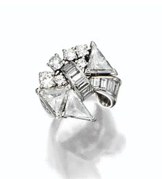 DIAMOND BOW RING, CIRCA 1935. The stylized bow composed of 3 triangular-shaped diamonds, 6 round diamonds and 13 baguettes, mounted in platinum