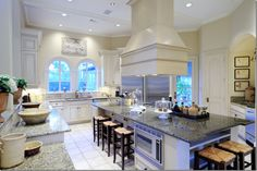 Pamela Pierce:  The stunning gray and white gourmet kitchen with modern amenities.