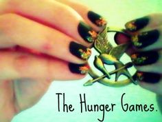 I decided to do a Hunger Games inspired Nail design and my Mockingjay pin finally came!! :D Im so excited for the premiere!! hollyannm