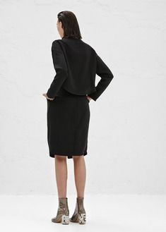 Rachel Comey Paloma Dress (Black) DETAILS Long-sleeved dress in black polyester with pleated front, boat neck and zip closure at back. Top half of dress connected at the middle of the waist in the front, but completely separated at back, allowing top to be tucked or untucked.