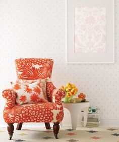Chose a beautiful, bold fabric and upholster a chair. You will be amazed at what a difference it makes in you room. #homedecor #orange