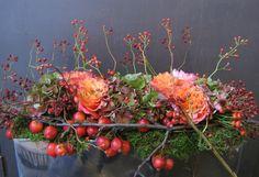 bloemstuk in warme herfsttinten