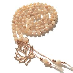 108 Mala necklace created with 6mm faceted Sunstone and round Peach Moonstone beads. Peach Moonstone Guru pendant with rose gold vermeil spacers, bead caps and a rose gold vermeil Lotus pendant. Strung on pale pink thread. Lotus symbolizes, purity, beauty, prosperity, fertility, peace, eternity and spiritual awakening. Sunstone: strength, vitality, clarity, abundance, inner radiance Peach Moonstone: love, destiny, hope, intuition, wisdom, new moon energy, new beginnings Rose Gold Vermeil…