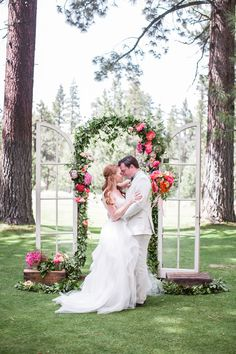 whimsical ceremony arch with glass pane doors and ginormous pink peonies. Wedding Flowers: Petalworks, Wedding Photographer: Jasmine Star, Wedding Coordinator: amazáe | events