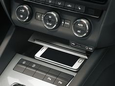 The phone box in the new ŠKODA Octavia. This draws from the aerial to boost your phone's signal Car Posters, Poster Poster, Mousepad, Cars, Phone, Box, Telephone, Snare Drum, Autos
