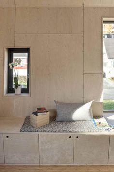 angular-home-addition-with-plywood-lined-interior-10-wall-panels.jpg
