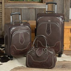 San Antonio 3 Piece Luggage Set in Coffee- Clean and classic is the look for this luggage set. Emblazoned with lots of studs for a true Western look, you'll enjoy watching for these pieces at the airport