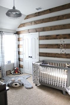 This pallet wall is so cool + fresh! It looks like they just did planks on every other spot, instead of the full wall...