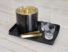 Austin Black Faux Leather Tray with Matte Black Ice Bucket withMatte Brass lid matched with Chisel DOF Glasses and Matte Brass Tongs