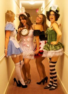 """I found this picture on Pinterest and pinned it because I have never understood why a group of people would want to dress up as characters from a movie, fairy tale etc. Halloween is my least favorite """"Hallmark Holiday"""". As you can see this is a picture of a group dressed up as the characters from Alice in Wonderland."""