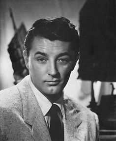 Promo still of Robert Mitchum heart emoticon for OUT OF THE PAST 1947.