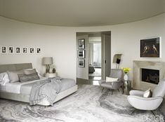 A Modernized Mid-century Home In Beverly Hills. In the master bedroom, a series of photographs by Alison Rossiter hangs above a custom-made bed upholstered in a suede. The armchairs are by Marco Zanuso; the vintage floor lamp is by Pierre Guariche. Luxury Interior, Interior Design, Interior Decorating, Beverly Hills Houses, Mid Century House, Elle Decor, Contemporary Furniture, Luxury Furniture, Contemporary Design
