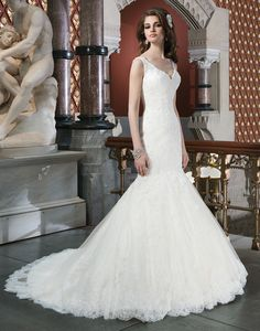 Justin Alexander wedding dresses style 8702 Beaded alencon lace appliques accent the chantilly lace mermaid  silhouette that features a V-tank neckline. Back is finished with a deep  V- neckline, chapel length train and regal satin buttons that cover the  back zipper.