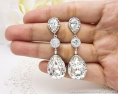 Wedding Dangle Earrings Wedding Jewlery Bridesmaid Drop Earrings Clear White Swarovski Crystal Tear Drops with Cubic Zirconia Connectors. $36.00, via Etsy.