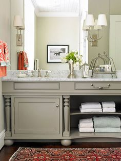 Simplify the storage in a vanity by removing the cabinet door and adding a shelf, creating easy-to-access storage. Towels in varying colors add to the bathroom's color scheme and keep guests from searching for a towel./