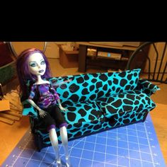 Monster High couch. Cardboard, duct tape, scrap fabric, and lots of hot glue.