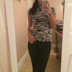 Zebra striped shirt Black and white zebra striped shirt. Short sleeved. Turtle neck. Worn only once. In perfect condition. No holes or marks. Can be worn with a black blazer or jacket in general! Tops