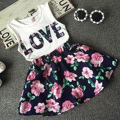 Floral patterns are in! Add pearls to your little girl for a classy, fun and sophisticated look. - 2 Piece Set - Polyester Skirt - Cotton Tank Top - Elastic Waistband
