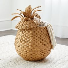 This pineapple-shaped floor basket has tons of tropical style, plus all the room you need to store toys, games and more. It features a water hyacinth weave over a durable metal frame, plus a gold finish and a lid for tucking clutter away. Style Tropical, Tropical Home Decor, Tropical Houses, Tropical Interior, Tropical Furniture, Tropical Bedrooms, Tropical Colors, Tropical Design, Tropical Party