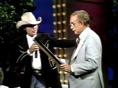 Dwight Yoakam giving platinum record to Ralph Emery