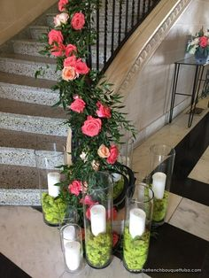 Stair Railing Fl Decor Of C And Peach Roses Ruscus With Moss Filled Vases