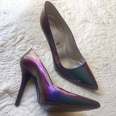 Iridescent patent leather heels Purple/green patent leather pumps. Never worn- with box. Perfect pristine condition, just never found the time to wear them! Still full price on the designers website. Pointy toe, very chic! Mashizan Shoes Heels