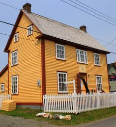 Trinity Museum, Newfoundland, is an salt box style house built by the DeGrish family. This house now holds a collection of over artifacts donated by people of the Trinity NF area and elsewhere. Newfoundland Canada, Newfoundland And Labrador, Saltbox Houses, Devon Uk, Salt Box, Atlantic Canada, Canada Eh, Yellow Houses, Travel Items
