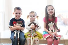 kids with fabric dolls